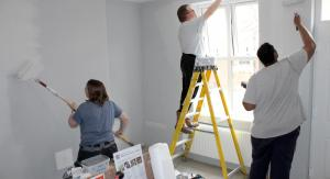 volunteers painting room