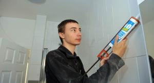 young man applying grouting