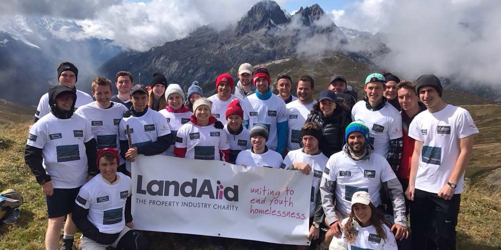 Group of Colliers graduates with LandAid banner on Mont Blanc