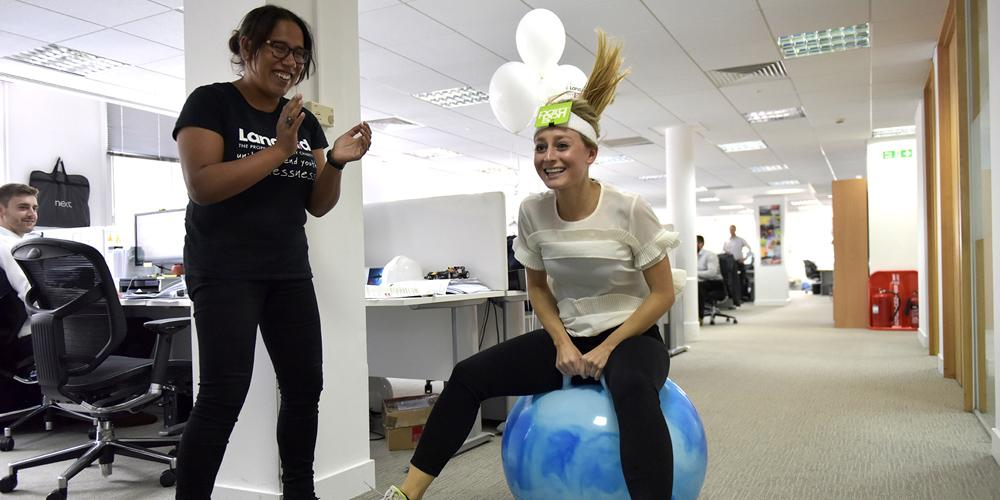 Woman racing on space hopper