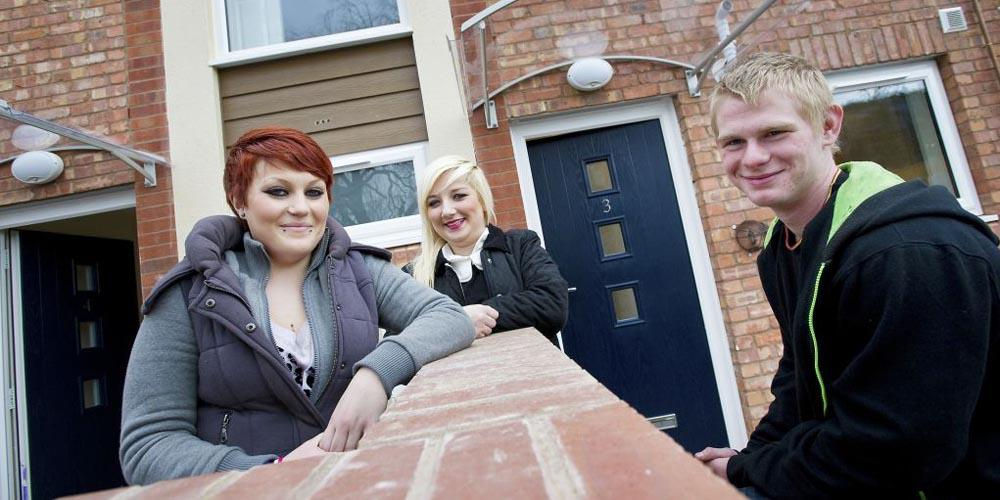 young people outside house