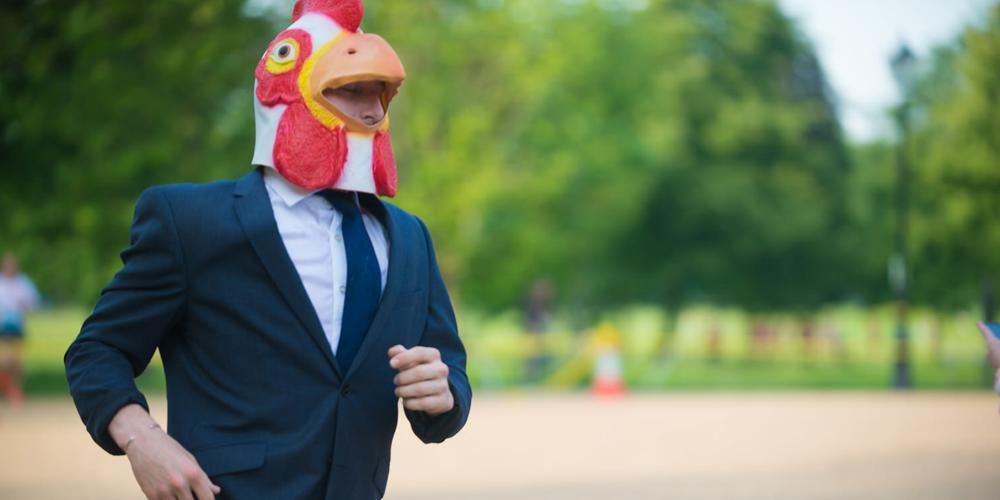 Man running in chicken costume