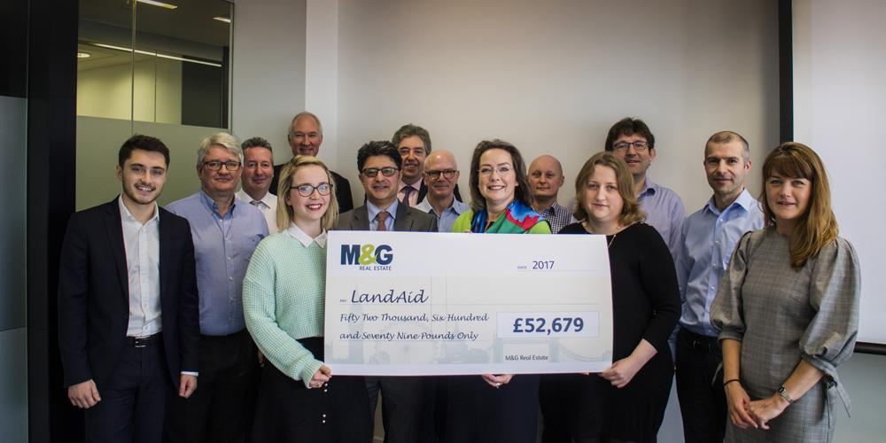 M&G Real Estate team presenting big cheque to LandAid