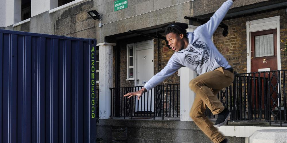 Young man jumping outside accommodation