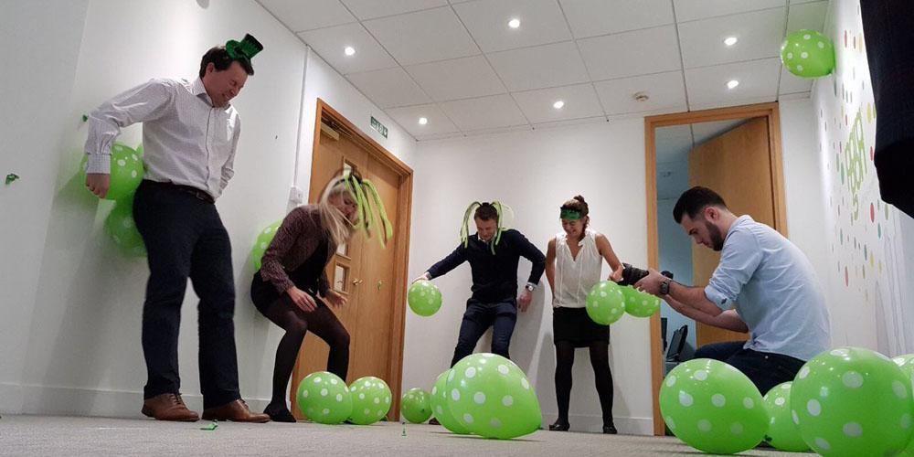 Colleagues attempting to set world record for popping balloons