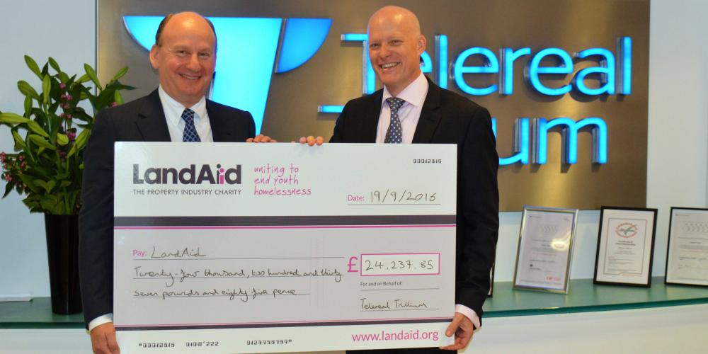 CEOs of LandAid and Telereal Trillium with big cheque