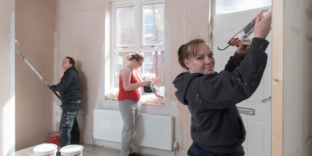 young women decorating room