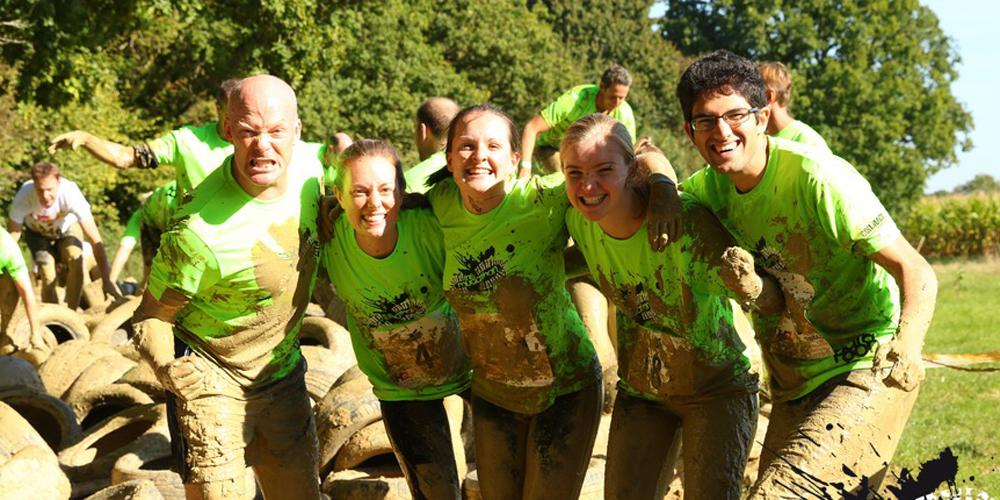 Group of muddy competitors