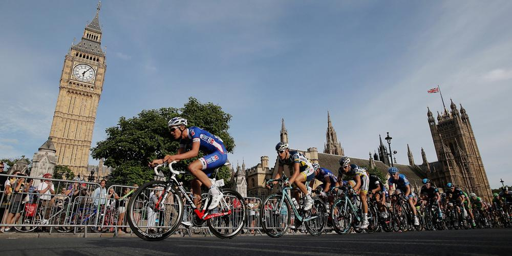 cyclists ride past Big Ben
