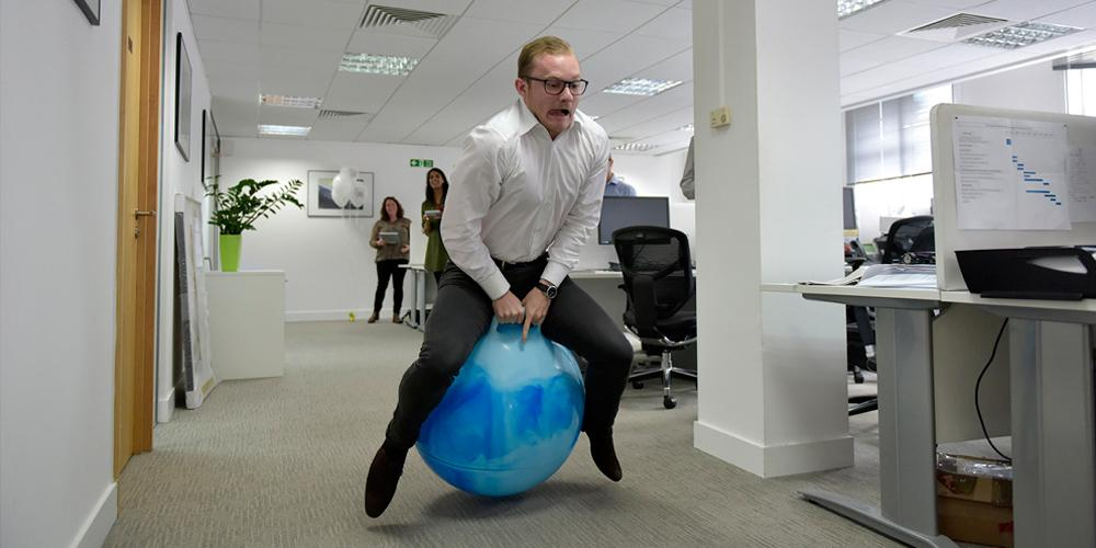 man on space hopper