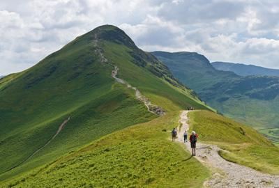 catbells mountain with walkers on path