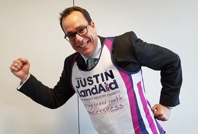 Justin wearing LandAid running vest over his suit