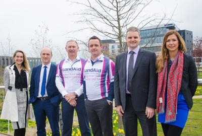 Group of LandAid Midlands 10K supporters smiling at Longbridge site