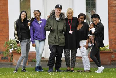 Group of young people standing outside St Basils accommodation