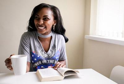 Young girl reading and smiling