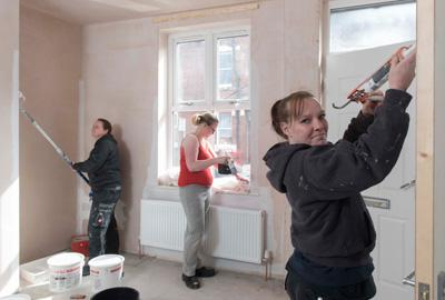 three women redecorating room