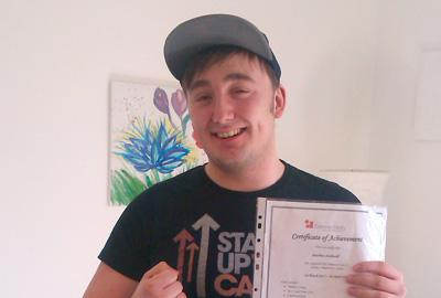 young man holds certificate