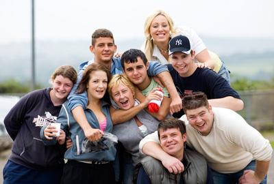 group of young people hugging