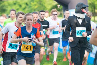 man dressed as penguin in running race