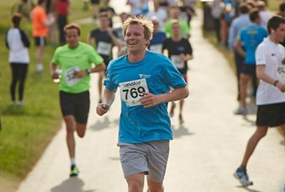 man running towards finish line of race